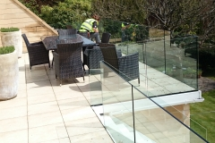 Nicky-Cleaning-Glass-Balcony